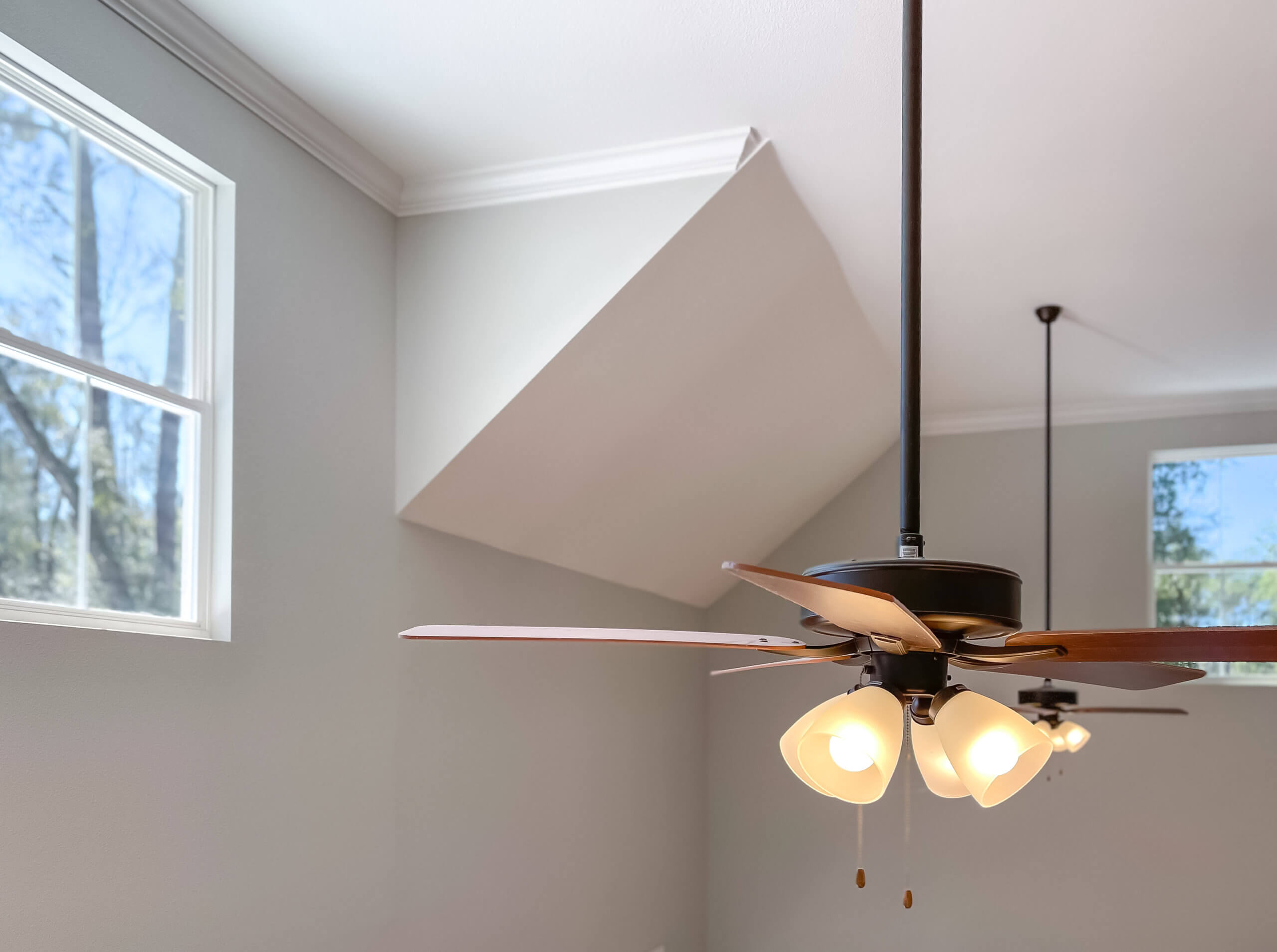 Get The Most Out Of Your Air Conditioning This Summer With Ceiling Fan Installation